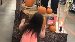 Little Girl Dances To Halloween Theme In A Spirit Store
