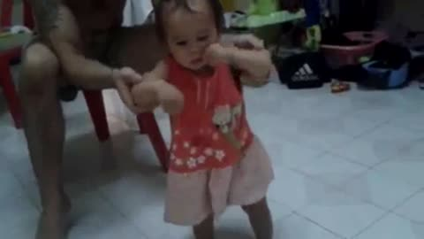A 12 month old's first steps.