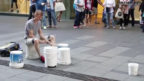 Street performer displays amazing drumming skills