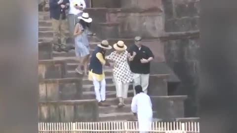 Hillary nearly falls down stairs in India