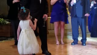Little Girl Gives Rambling Speech To Bride And Groom