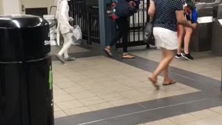 Small person kid dressed in all white subway station - Video