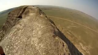 Daredevil rides unicycle over 200 foot cliff! - Video