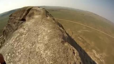 Daredevil Rides His Unicycle Over 200 Foot Cliff