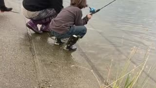 Young Boy Catches a Big Fish in South-Central Alaska