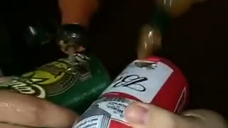 Guys putting hot sauce in beer cans  - Video