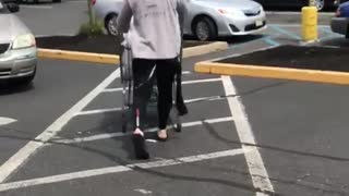 Guy coming out of grocery store with black wet suit