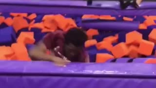 Guy red shirt back flip into purple orange foam fit hits face on floor then blonde girl falls on him