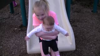 Big Sister takes Little Sister down the Slide