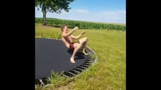 Guy in red shorts fails at trampoline flip  - Video