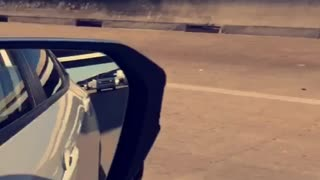 Remote Controlled Race Car Speeding Down A Busy Freeway - Video