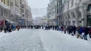 Snowball fight in a big city