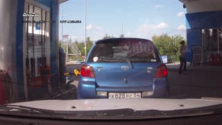 Woman Forgets To Remove Gas Nozzle