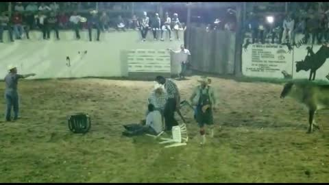 4 guys sitting in chairs get taking out by bull