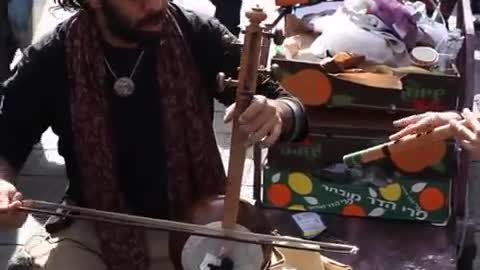 cultures from around the world - Israeli kamancheh player at market, Jerusalem, Israel Episode 2