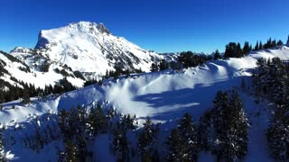 Drone captures breathtaking mountain snowboarding footage - Video