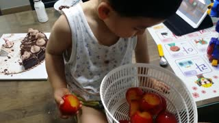 Adorable Toddler Busted For Wasting Fruit  - Video