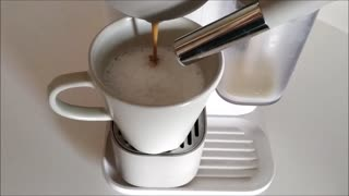 Coffee falling into the cup