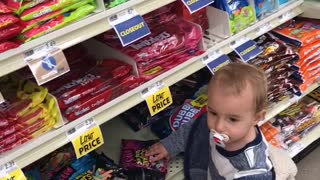 Baby has a sweet tooth while food shopping  - Video
