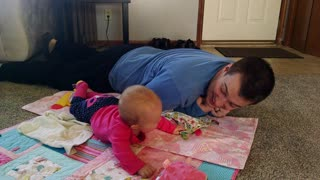 Adorable baby girl laughs at dad crawling - Video