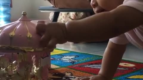 Cat Watching A Small Baby Playing With Her Toy