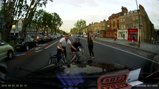 Lucky Cyclist on Mile End Road - Video