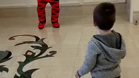 3 year old has a jump off battle with Tigger at Disney World