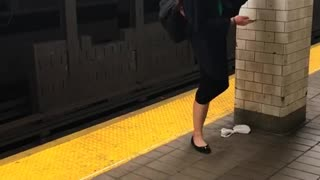 Girl does splits on wall on subway platform