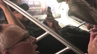 Old guy green shirt glasses singing clapping hands train subway - Video