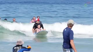 This Famous Surfing Dog Rides The Wave To Helping Others! - Video