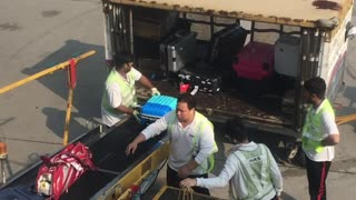 Hong Kong Airport Employees Toss Luggage Carelessly