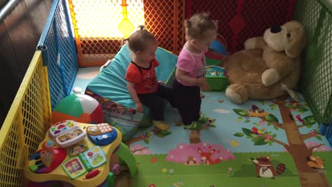 Twin girls play trust game for first time