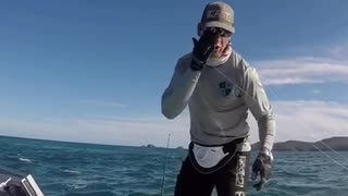Man on boat in ocean gets hit by fishing pole - Video