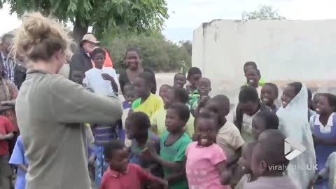 African Children Hear Fiddle For The First Time