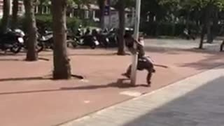 Rollerblading guy runs into light pole cant stop