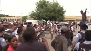 Tense protests after Chicago Police shoot and kill a man in South Shore