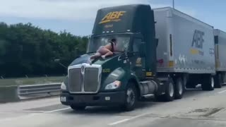Viral video shows Florida man jump, hold onto the hood of a moving semi-truck