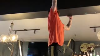 Manager Attempts to Remove Sticky Bra from Ceiling