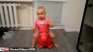 Adorable baby loves her rubber donkey