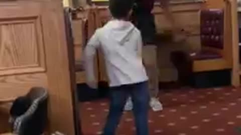 Kid has floss dance-off with member of restaurant staff