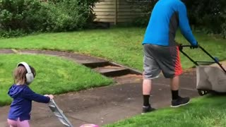 Father And Daughter Take Lawn Mowing Very Seriously - Video