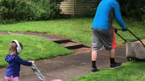 Father And Daughter Take Lawn Mowing Very Seriously