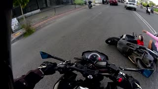 Motorcycle Crash Involving Mother and Child - Video