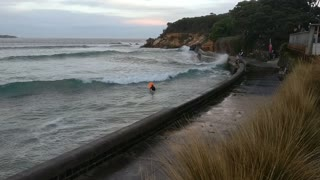 Kids Catch Waves Using Seawall - Video