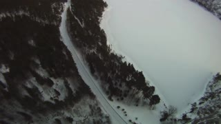 Winter BASE jump from an icy cliff