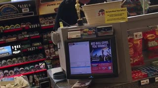 Talkative Cashier Checks Out Products In A Rock 'N' Roll Beat  - Video