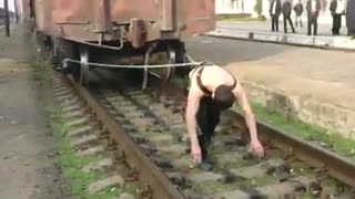 Supernatural man dragging a train with a rope - Video