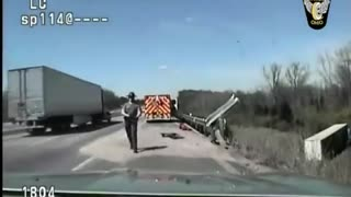 Dash Cam Captures Moment When Heroic Officer Saves Trucker's Life - Video