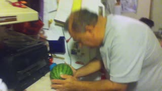 Man tries to break watermelon with his head