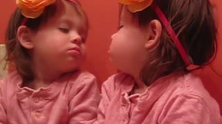 Girl distracted by own reflection while singing ABCs - Video